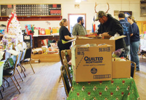 Members of Rangely Elks Lodge No. 1907 began preparing Christmas food boxes at 6:30 a.m. for distribution around Rangely on Dec. 22. Approximately a dozen helpers stuffed 75 gift boxes with food, candy and toys for families in and around Rangely and Dinosaur.