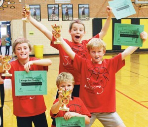 Peter Hanks, Liam Deming, Zagar Brown and John Hampton Hightower (top right), were the Sparkling Warriors, who won the boys' third- and fourth-grade division.