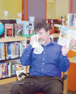Amid a month's worth of library events, Meeker Elementary School Principal Jason Hightower read the fairy tale melodrama 'Gold Miner's Daughter' to each class as a reward for doing so well in checking out, reading and returning the books to the school's library.