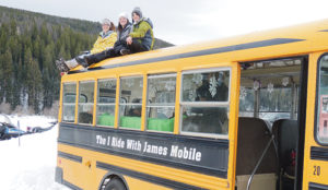 From left, Gretchen Rachlins, Sarah Sizemore and Amber Ybarbo stand watch atop James Sizemore's memorial bus as they count the riders in the third annual 'I Ride with James' Poker and Snowmobile Ride on Sunday, starting at the Lost Creek Trailhead, about 30 miles up County Road 8. More than 200 participants, volunteers and spectators took part in the fund-raising event for the James Sizemore Memorial Scholarships and Rio Blanco County Search and Rescue.