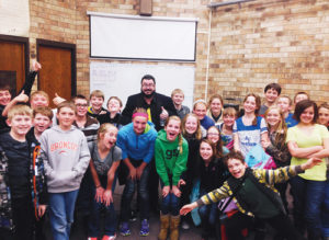Chris Bowers and the sixth-grade class at Barone Middle School.