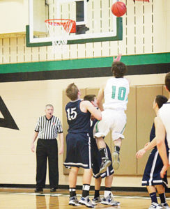 Rangely senior Connor Phelan goes up for two of his 11 points against Vail Christian.