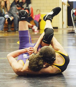 "Shepherd is pictured using a ""Meeker Cradle"" to score back points in the Meeker dual meet tournament Saturday."