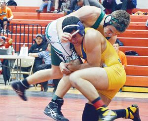 Panther junior Ethan Allred uses a cross face against Bloomfield, N.M., opponent J.D. Robinson in the 160-pound championship match, which Robinson won. Robinson was a New Mexico state consolation champion last year. The Panthers will wrestle in Crowley County this weekend.