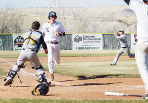 Rangely senior Cameron Enterline crosses home plate safely as Meeker senior Dylan Mobley tries to get the ball to catcher Tanner Matrisciano to prevent the winning run in the second game of a doubleheader in Rangely. The Panthers won both.