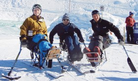 Colorado Northwestern Community College rodeo coach Jed Moore added a new component to the annual winter festival tradition in Steamboat Springs. He invited several cowboys and cowgirls with spinal cord injuries to join the competition. From left to right, Amberley Snyder, Billie Sutton and Jed Moore pose on the mono Sit Skis provided by Steamboat STARS Adaptive Skiing Program.