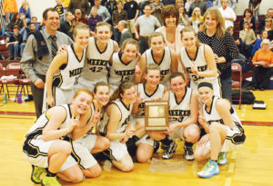 The Meeker girls' basketball team won the district championship and will take a 20-2 record and the No. 1 seed into the state-qualifying regional tournament in Palisade, starting Friday, when they play Nucla at 3 p.m. Pictured with the district championship team plaque are, in front: Sydney Hughes, Piper Haney, Aly Ridings, Taylor Neilson, Deena Norell and Megan Parker. In back: head coach Greg Chintala, Taylor Morris, Reece Pertile, Anna Walsh, Alex Duell, assistant coach Julie Bowman, Jamie McLaughlin and assistant coach Karen Dinwiddie.