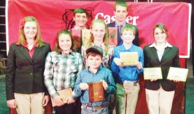 Members of the Rio Blanco Livestock Judging team show off some of the awards they have won in the past month from their competitions. In the back row, from left, are: Justin Mosher and Ty Dunham; middle row, from left: Samantha Lapp, Marryn Shults, Jilly Baumgartner, Macy Collins and Madi Shults; front row: Hayden Shults.