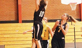 Rangely eighth-grader Katelyn Brown (10) goes up for a shot in one of her team's final games of the AAU season. Brown's team beat Meeker by one point, and both teams lost to Rifle in Meeker.