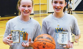 Rangely Middle School sisters Kassidee and Katelyn Brown are pictured with some of their winnings from the 2014 Nuggets Skills Challenge, which Katelyn won at the state level.