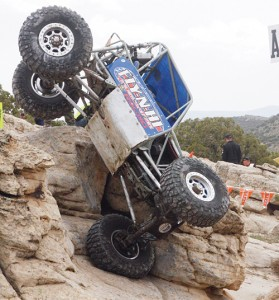 In the unlimited class at the World Extreme Rock Crawling Championship event in Rangely on April 27, Justin Keilman and spotter Airen Patrick from Arizona balance their buggy on one wheel during the A3 obstacle bonus drop on Saturday. Eighteen teams and individuals were in Rangely for the competition.