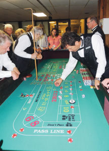 Employees of Full House Casino in Denver worked as dealers and croupiers for Saturday night's 2014 Spring Gala Black and White Masquerade Ball at the Fairfield Center in Meeker as part of the casino night portion of the fundraiser. The tables stayed full for the night as participants were vying to see who could make the most funny money.