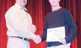 Anthony Mazzola presented several awards at the May 8 awards assembly at Meeker High School, and, above, Mazzola presented the White River Electric Association Rural Youth Tour Award to senior Jake Phelan, who also received the Masonic Arts and Science Award.