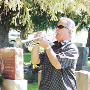 "Meeker's Tom Allen plays ""Taps"" to conclude the Memorial Day service held Monday at Meeker's Highland Cemetery. The service is held each year to remember the men and women from the Meeker area who gave their lives in military service to their country. There were well in excess of 100 people at the ceremony in the cemetery Monday morning."