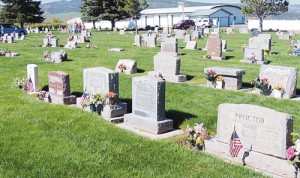 Highland Cemetery in Meeker was a busy and colorful place on Monday as family and the VFW had decorated many of the graves. The VFW placed American flags on the graves of former service members and the Stars and Stripes were in wide evidence throughout the property.