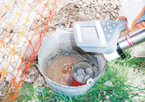 "The Folgers coffee can inside this bucket was filled with ""significantly radioactive"" uranium when the home at 1189 Park St. in Meeker was demolished late last week. A couple more small samples of the ""hot"" ore were found in the backyard. The radioactive material as well as surrounding soil and the residence have all been cleared up and shipped to a nuclear waste dump site near Steamboat Springs."