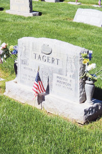 The headstone of Meeker's George G. Tagart at Highland Cemetery is decorated with an American flag to designate him as one of the many veterans buried in the local cemetery. The Meeker VFW performed ceremonies on the bridge over the White River in Meeker Town Park and then proceeded to hold another remembrance at Highland Cemetery.