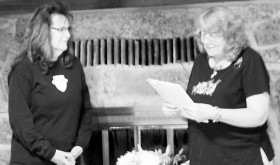 Brenda Hopson, right, president of Rangely's Epsilon Chi service sorority, presents its Outstanding Volunteer of the Year Award to Rangely's Diane Sizemore, left, on March 1 for all the volunteer work she does in the local schools and around the community.