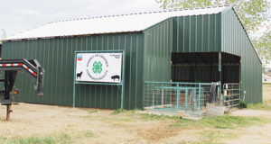 A roustabout crew hired by WPX Energy finished most of the 4-H pen rebuild project in Rangely in just over a week. On Wednesday, the building frame was in place. By Sunday afternoon, the building was complete, replacing the old pen, which was severely damaged in a fire on May 5.