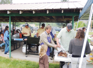 Members of the Meeker Lions Club, right, helped feed several area residents and their children as part of the Meeker Kids' Fishing Day on Saturday at Circle Park. Roughly 125 trout were stocked in the back irrigation ditch by Colorado Parks and Wildlife for the occasion, and children of all ages tried their luck at catching the fish from 10 a.m. to 1 p.m.