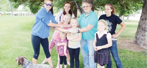 Members of the Makin' Bacon Livestock 4-H Club in Rangely presented Rangely Animal Shelter director Vicky Pfennig the funds raised from the Walking and Wagging 5K dog walk. Makin' Bacon sponsored the walk that attracted 33 Rangely residents and 4H members, raising $360 for the shelter. Pictured are: Makin' Bacon vice president Brittany Babineaux and Cooper; director Vicky Pfennig; club members Klaire Denny and Kadence Wagner as well as the first-place finishers Sarah, Rylee and Olivia Wagner.
