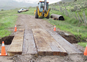 The Rio Blanco County Road and Bridge Department put planks across County Road 51 where the culvert washed out (mile post 0.7) on the Wyman Lake Road. Using caution, ATVs and OHVs are able to cross the temporary structure, but no highway vehicles. A culvert that crossed the road washed out, and the county will replace it after high water subsides, tentatively by July 1. CR 51 accesses the White River National Forest to Wyman and Aldrich Lakes and is a popular camping and fishing area.