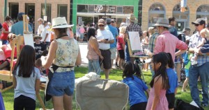 Several hundred residents and visitors ate lunch and had fun on the lawn around the Rio Blanco County Courthouse while artists taking part in the Range Call Plein Air Art Competition went about their business in the Quick Draw phase of the competition on Friday morning.