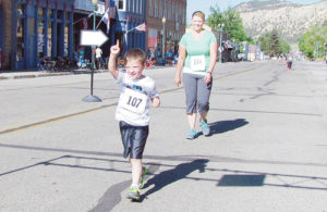5-year-old Orion Musser feels like he is No. 1 as he finishes in front of Cherlynn Muxlow