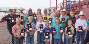 Above are the buckle winners from the 2014 Rio Blanco County Fair horse competition held Saturday at the Rio Blanco County Fairgrounds arena in Meeker. Front row, from left, are: Connor Blunt, Kelton Turner, Deana Wood, Leah Wood, Cade Blunt, Sage Jensen and Lane Anderson. Back row, from left, are: Tammy Burch, Kelten Burch, Tom Sharpe, Taylor Elliott, Amber Elliott, Andy Urista, Kenzie Turner, Ellie Anderson and Nishiko Thelen.