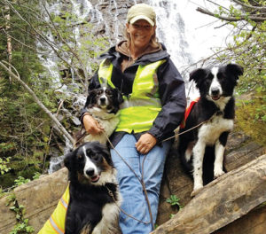 Dog handler Chris Jobe gets some hiking exercise for herself and three of her dogs at home in Alberta, Canada. Jobe will be in Meeker for the Meeker Sheepdog Championship Trials, held Sept. 3-7.