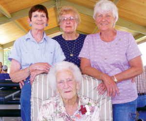 Mossie Percifield, seated, turned 100 on Aug. 8, and was joined in a celebration by her daughters, top, from left to right: Betty, Patty and Sandy.
