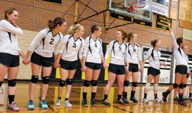 Meeker High School volleyball players are introduced before a home match last Saturday.