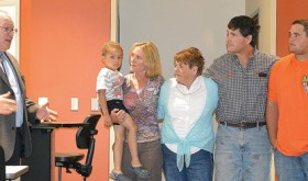On hand for the dedication of the remodeled and expanded Rector Science Building on the Rangely campus of CNCC were, from left, CNCC President Russell George; Peggy Rector's daughter-in-law, Rebecca Rector holding her nephew, Quinton; Peggy Rector; her son, Jeff Rector; and grandson, Brian Rector.