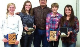 This photo was taken at the 2014 Colorado State Fair ceremony in Pueblo for the 4-H members who made the Junior and Senior All-State livestock judging teams. Rio Blanco County 4-H had four livestock judges make the all-state teams this season. From left to right are: Kenzie Turner of Meeker, a first-year member of the Junior All-State  Team; Samantha Lapp of Rangely, a two-year qualifier for the Junior All-State Team;  Coach Clint Shults of Meeker; Macy Collins of Meeker, a first-year member of the Junior All-State Team; and Madi Shults of Meeker, a fifth-year  member of the Colorado All State 4-H Livestock Judging Team. Of the 10 junior members making the all-state team, eight were from the Western Slope.