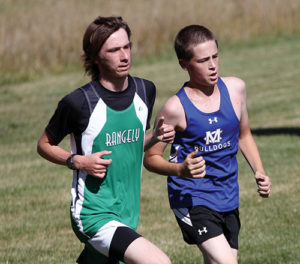 Rangely distance runner Zack Glasgow gives his best effort, finishing 11th at the Moffat County Invitational cross country meet.
