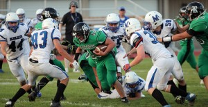 Rangely Panther running back Ethan Allred (45) breaks the line to gain some of the 101 yards on 16 carries that he earned during Rangely's 40-6 defeat of Mancos on Friday. For the game, Allred also added two touchdowns and a two-point conversion. On Friday, the Rangely gridders will head south for a non-league contest against the Dove Creek Bulldogs.