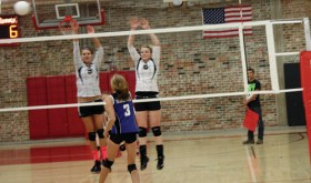 "Meeker High School seniors Paige Jones and Reagan Pearce reach above the net to defend a high shot against Moffat County during a match in Aspen. The Lady Cowboys opened the season with four matches, winning three and losing one. ""It was a good learning experience, but we have a lot to work on,"" said first-year head coach Janae Stanworth. Meeker will play Vail Christian in Vail on Friday."