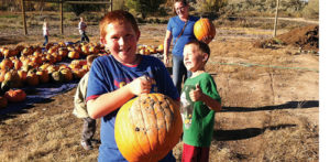Cory Shonts gives big brother Nate a thumbs-up for his choice of pumpkin at the Rangely Community Gardens while the boys' mom, Janette Shonts, looks on. The Gardens gave away more than 550 pumpkins to area residents this year.