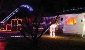 Rangely firefighter Mike Cushman kept his Christmas decorations, which depict a firefighter putting out a house fire, on familiar territory following his occupation. The lights, which depict two firemen and a pumper truck, are located at 215 W. Rio Blanco.