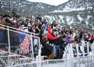 Despite dismal weather, a large number of fans from Meeker made the trip to watch the Cowboys.