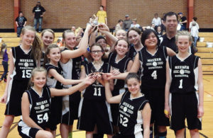 On Saturday both of the Barone Middle School girls' seventh grade basketball teams won their respective tournaments. The seventh grade A and B teams were victorious with the seventh grade A team soundly defeating Moffat County by a 50-14 margin while the B team defeated Steamboat Springs in a low-scoring 21-11 contest. Members of the champion Barone Middle School girls seventh grade A and B basketball teams are: Back row, left to right: Caleigh Morlan, Jilly Bumguardner, Addie Joy, Sarina Goedert, Karlee Neilsen, Julia Dinwiddie and coach Tom Knowles. Middle row, left to right, are: Kirsten Brown, Madison Kindler, Makenna Burke, Lorena Martinez and Matilda Brown. Kneeling from left to right are: Annalise Amack and Jaydenn Archuleta.