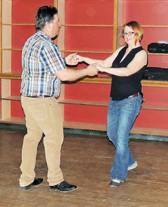 Roughly 100 people, teens to adults, took part in the free Valentine's Day dance at the Hugus Building in Meeker on Saturday. The Clover Loafers from Meeker provided dance music along with free appetizers from Wendll's and a cash bar run by the Meeker Lions Club. The Clover Loafers played a wide array of music for the audience.
