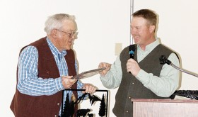 Ed Coryell, left, was honored at the Rio Blanco County Stockgrowers' Association dinner on Saturday for his 35 years of service as Colorado Brand Inspector. A good crowd was on hand for the group's annual meeting on Saturday afternoon and the dinner and dance Saturday night. The award was presented by Stockgrowers' Association President Kelly Sheridan, right.