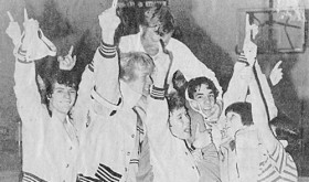 Coach Bill Turner pictured with one of his many winning wrestling teams.