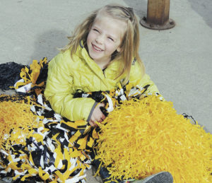 While quite a few folks gathered along Main Street in Meeker on Wednesday morning to send off the Meeker High School boys' basketball team to the state tournament in Pueblo over the weekend, Reagan Clatterbaugh demonstrated her own excitement by covering herself in MHS pompons at the intersection of Sixth and Main streets and cheering on the team as they left town.
