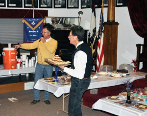 "On Sunday, the masonic brothers of Rio Blanco Lodge No. 80, AF and AM, held their annual celebration of George Washington's birthday with food, refreshment and a dessert auction. The proceeds of the auction go toward scholarships for local high school graduates to attend in-state schools. George Washington was initiated into Freemasonry in October 1752, at the age of 20 and by August of the following year was raised to Master Mason. Although there were many masons during our nation's founding years, George Washington is held by many as one of the finest examples of duty to God, our nation, our neighbors and ourselves. This year marks the 125th anniversary of the charter for Meeker's Rio Blanco Lodge No. 80 and members look forward to a new year of brotherly love, truth and charity. Left, friends and Masons celebrate George Washington's birthday as auctioneer Paul ""Buckshot"" Sheridan and Danny DeWitt help the Masons support local scholarships."
