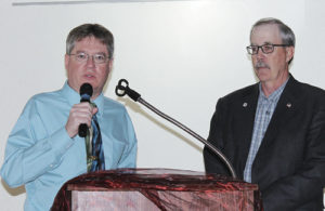 "Marshall Cook, left, the new fire/EMT chief for the Rio Blanco Fire Protection District, was welcomed to the new position by 16-year fire chief Steve Allen, right, who recently retired, during the district's ""Annual Gala Banquet Honoring Meeker Volunteer Fire and Rescue,"" which was held March 14 at the Fairfield Center in downtown Meeker."