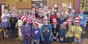 Read Across America was celebrated the week of March 2-6 at Meeker Elementary School.During library, the students learned about Theodore Seuss Giesl and his love of illustrating and writing books for children. Seuss' birthday party was held on March 2. To start the day, 26 high school Life Skills students read a Seuss book to each class. Shana Holliday's marimba band performed as everyone came in and settled down and  Kathleen Kelley's high school English literature class performed four Dr. Seuss books in reader's theater. Pictured above is Renay Mobley's fourth-grade class in the library.