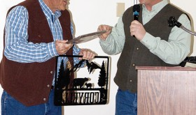 Ed Coryell, left, was honored at the Rio Blanco County Stockgrowers' Association dinner on Feb. 7 for his 35 years of service as Colorado brand inspector. The award was presented by Stockgrowers' Association president Kelly Sheridan, right.