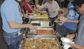 A long line of hungry folks dug into nine entrées, elk dip, potatoes, salad and vegetables as part of the sixth annual Wild Game Dinner on Saturday night at CNCC-Rangely.  The event included music by Rangely group Fiscus & Gravy and silent and vocal auctions. Roughly 100 people took part in the event.